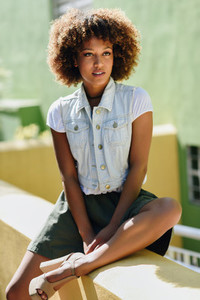 Black woman  afro hairstyle  wearing casual clothes in urban bac