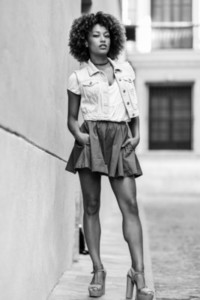 Young black girl afro hairstyle standing in urban background