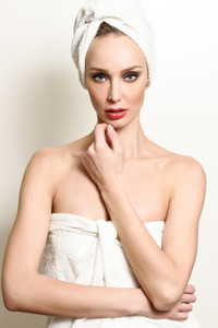 Beautiful blond woman with white towel on her head
