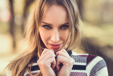 Close up portrait of young blonde woman with blue eyes