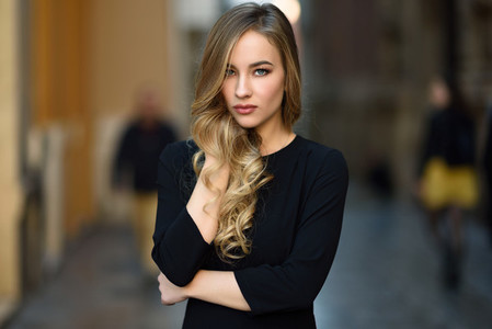 Beautiful blonde russian woman in urban background