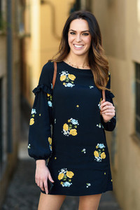 Young woman walking in urban background  Female in casual clothes with care hair