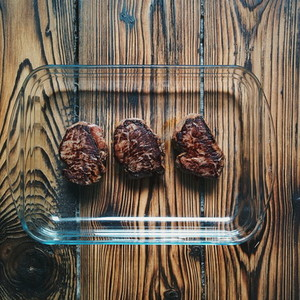 Steaks on a wooden background