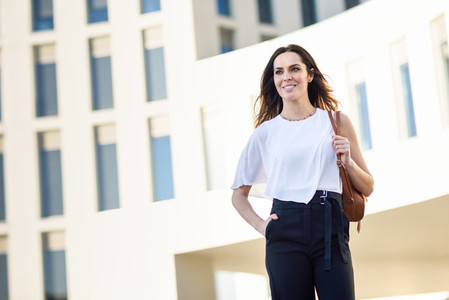 Confident businesswoman standing outside an office building