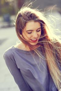 Happy blonde girl in urban background