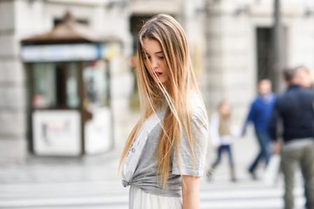 Blonde girl urban background
