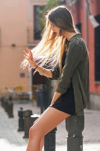 Blonde girl moving her amazing long hair