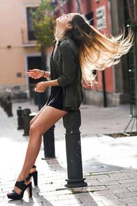 Blonde girl moving her amazing long hair