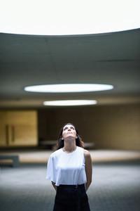 Beautiful brunette woman  model of fashion  posing in modern building