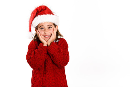 Adorable little girl wearing santa hat isolated on white backgro