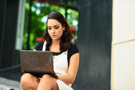 Businesswoman wearing casual clothes working outdoors
