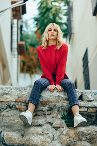 Blonde girl with red shirt enjoying life outdoors