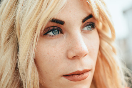 Young blonde girl with beautiful blue eyes