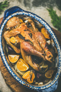 Roasted chicken with orange for Christmas eve celebration table