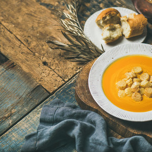 Fall pumpkin cream soup with croutons and seeds  square crop