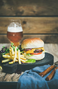 Classic burger dinner with french fries  salad  beer