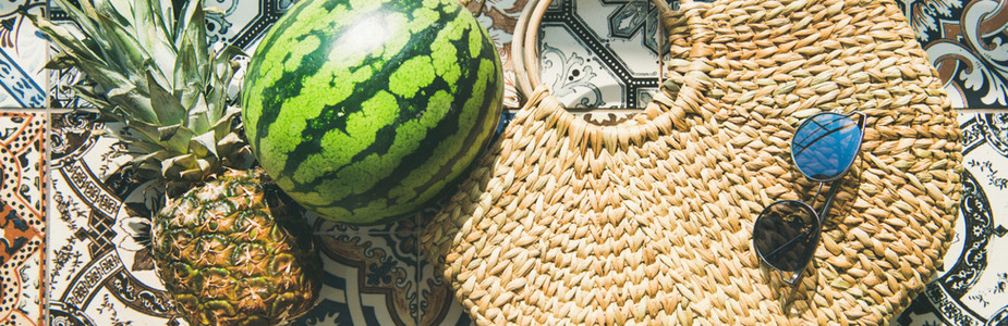 Summer lifestyle background with fruits and straw bag wide composition