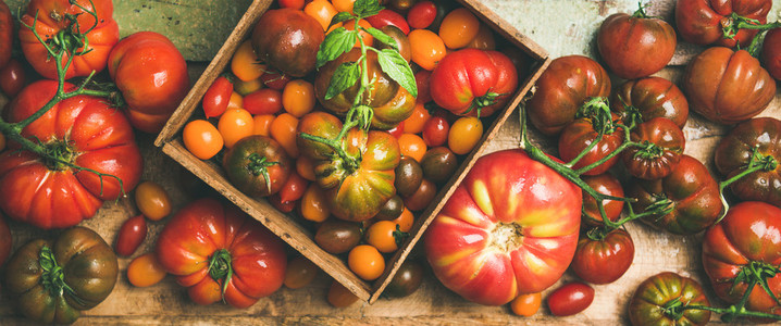 Flat  lay of fresh colorful tomatoes variety
