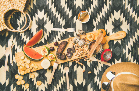 Picnic concept with sausage fruit nuts cheese and pate