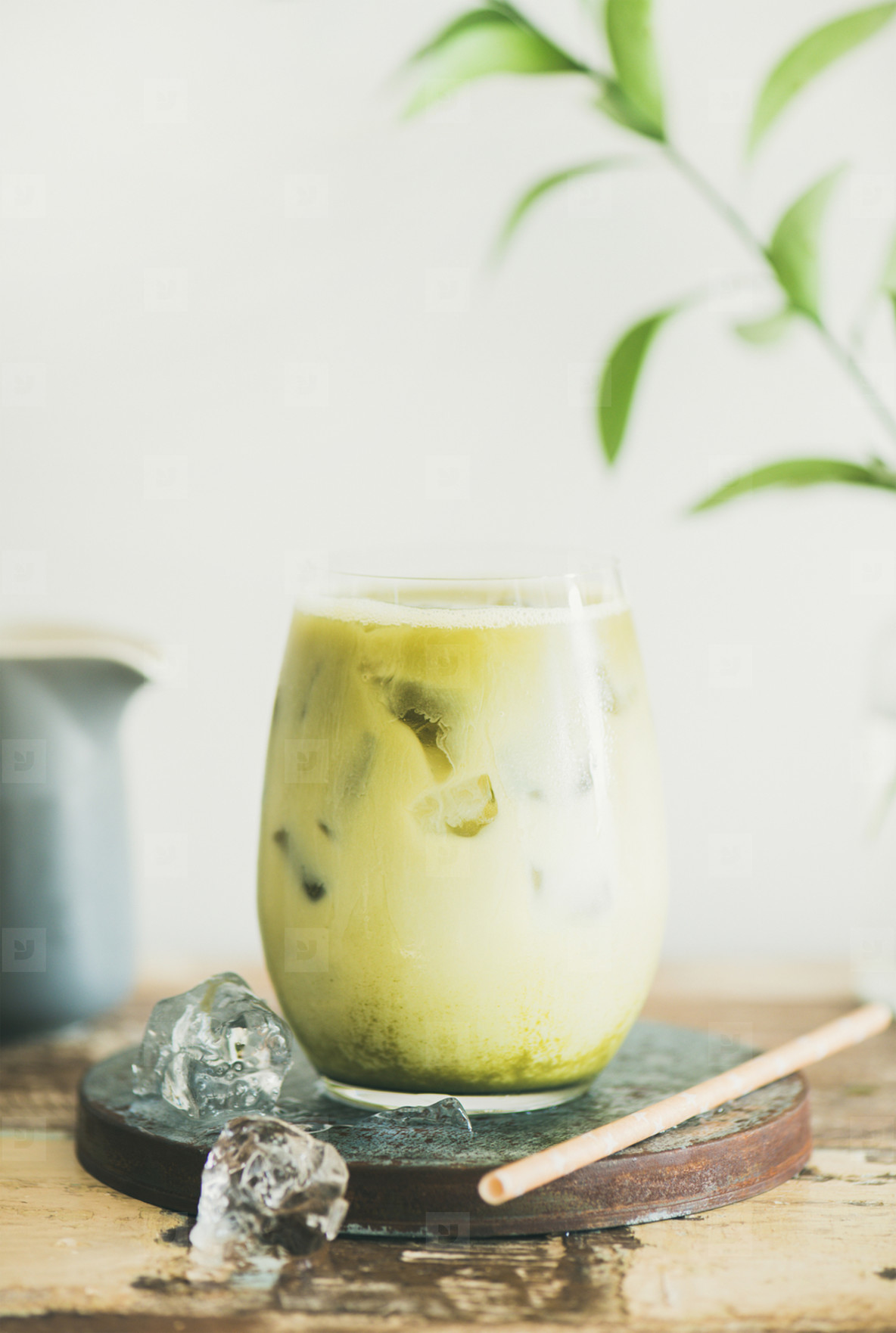 Iced matcha latte drink  white wall at background  close up