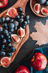 Top view of Autumn food flat lay with season fruits and vegetables like Bangalore blue grape  red apples and figs on a table