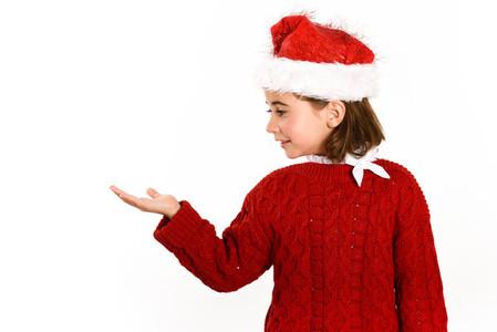 Adorable little girl wearing santa hat isolated on white backgro