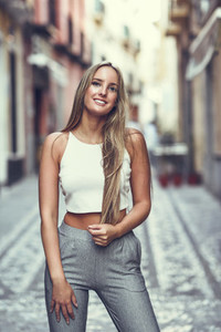 Beautiful young blonde woman  straight hairstyle  in urban backg