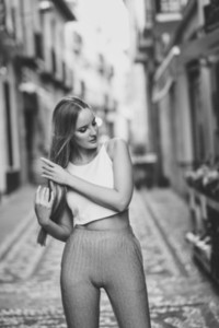 Beautiful young blonde woman  straight hairstyle  in urban background