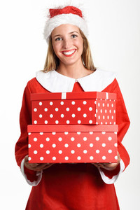 Blonde woman in Santa Claus clothes smiling with gift boxes