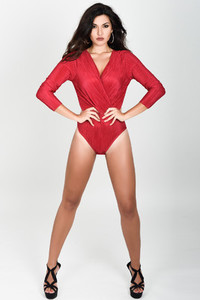 Young woman wearing red body and earrings on white background