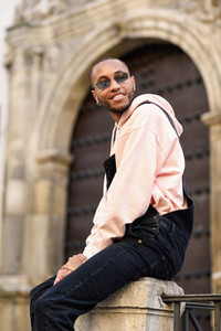 Young black man wearing casual clothes and sunglasses outdoors