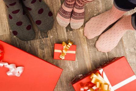 Feet of three people family on wood floor