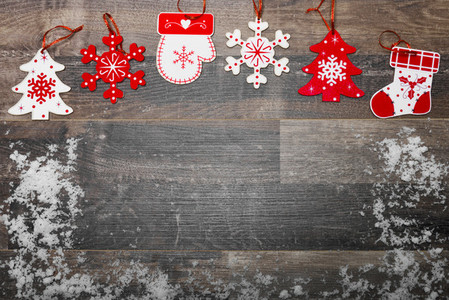 Christmas background with ornaments on wooden board