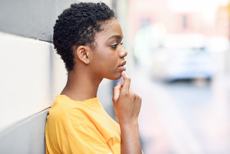 Thoughtful black woman with sad expression outdoors