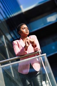 African businesswoman standing near business office building