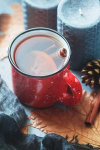 Mulled wine in a red ceramic mug