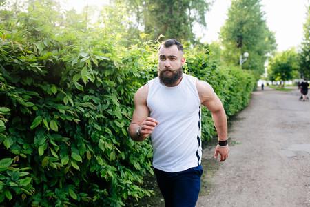 bearded man runs