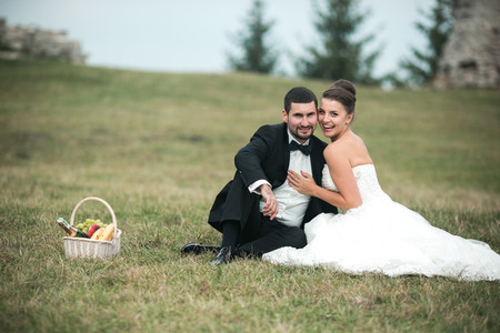Wedding couple siting on the grass