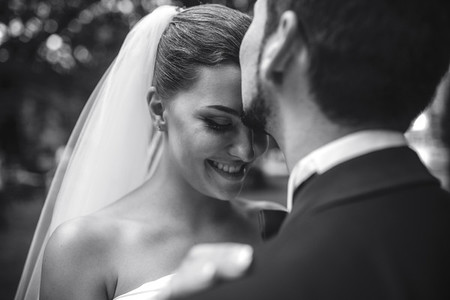 beautiful bride caress gently  the grooms face