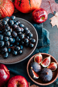 Autumn food flat lay with season fruits and vegetables like Bangalore blue grape  red apples and figs on a table