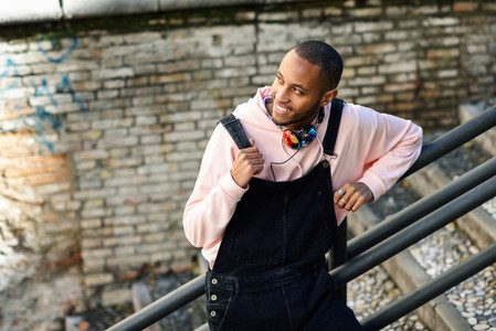 Smiling black man wearing casual clothes outdoors