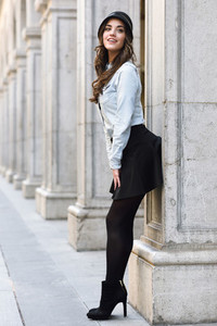 Woman in urban background wearing casual clothes