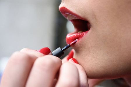 Attractive womans mouth with fashion red lips makeup