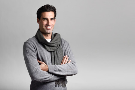 Handsome man wearing winter clothes on white background