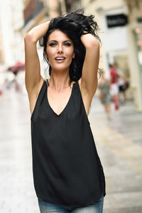 Brunette funny woman wearing casual clothes happy in the street