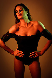 Young brunette woman in black lingerie with red and green lighti