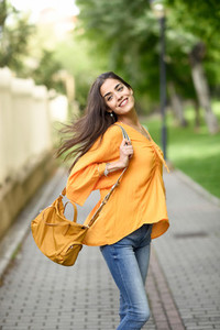 Woman with moving hair wearing casual clothes in urban backgroun