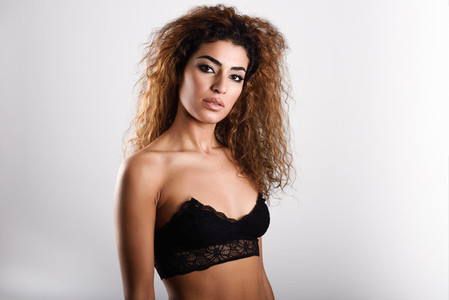 Young girl wearing black bra Studio shot