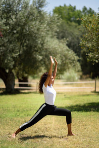 Young Arab woman doing yoga in nature