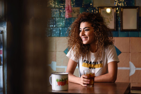 Arabic woman in a beautiful bar looking through the window